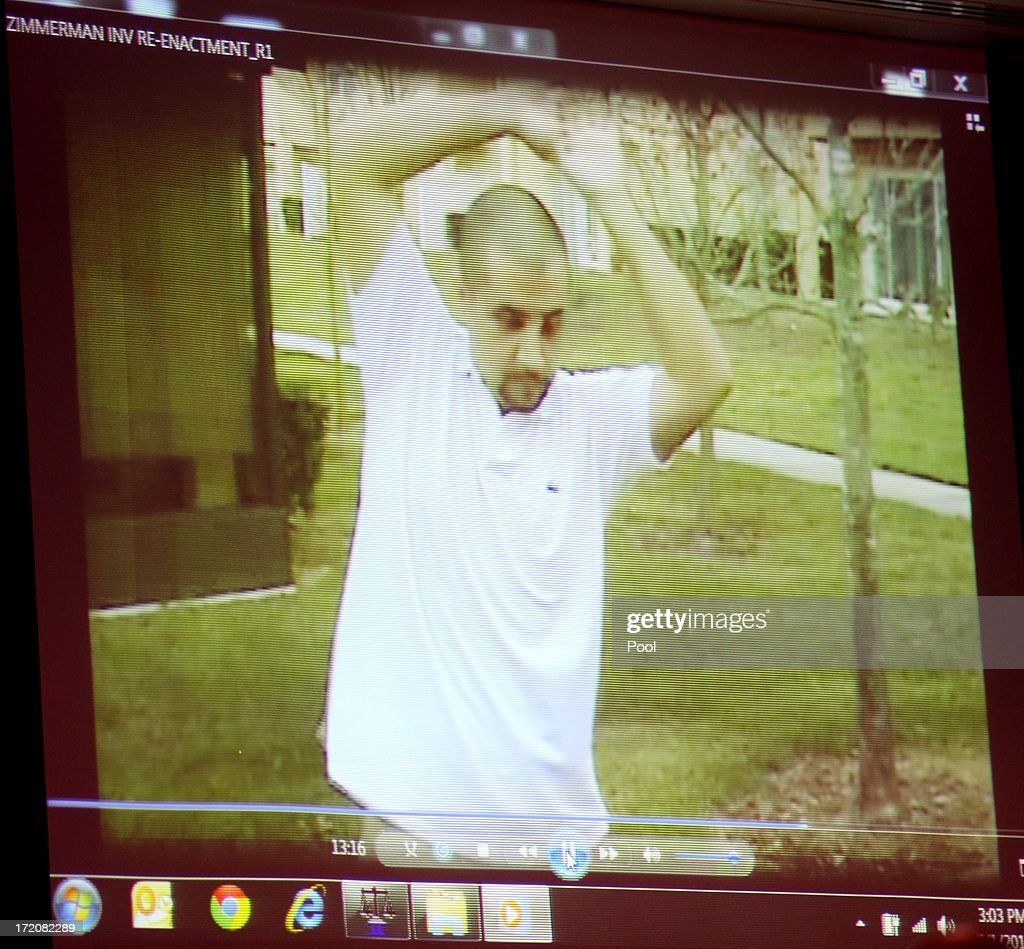A reenactment video showing George Zimmerman with Sanford police investigators, taken the after the Trayvon Martin shooting, is projected for the jury during the 16th day of his trial in Seminole circuit court July 1, 2013 in Sanford, Florida. Zimmerman is charged with second-degree murder for the February 2012 shooting death of 17-year-old Trayvon Martin.
