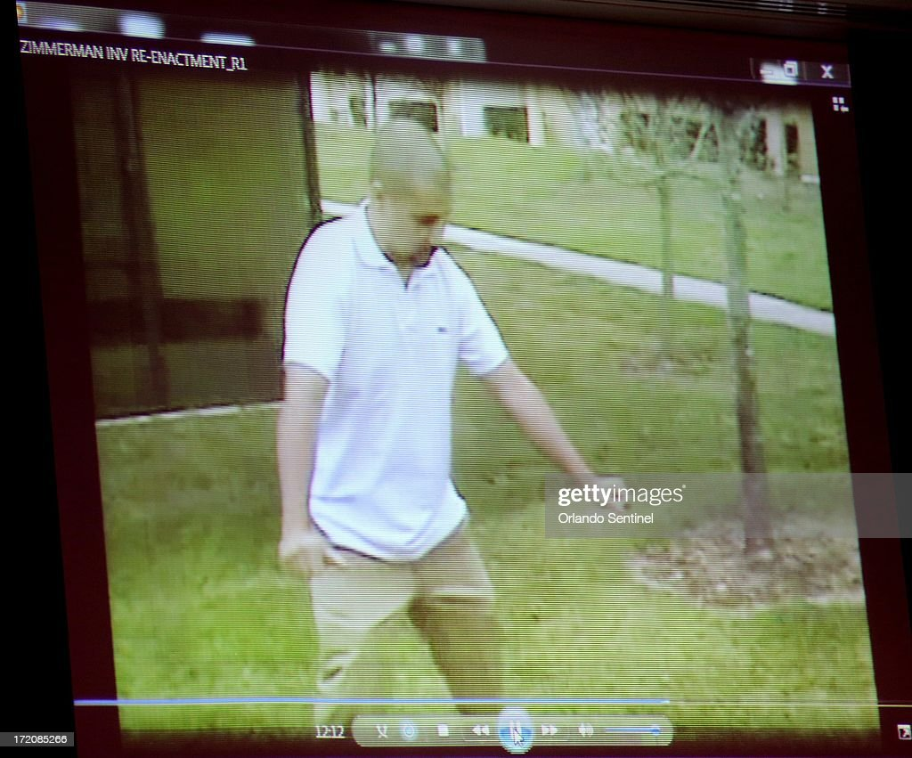 A reenactment video showing George Zimmerman with Sanford police investigators taken the after the Trayvon Martin shooting is projected in the courtroom during Zimmerman's trial in Sanford, Florida, Monday, July 1, 2013. Zimmerman is accused in the fatal shooting of Trayvon Martin.