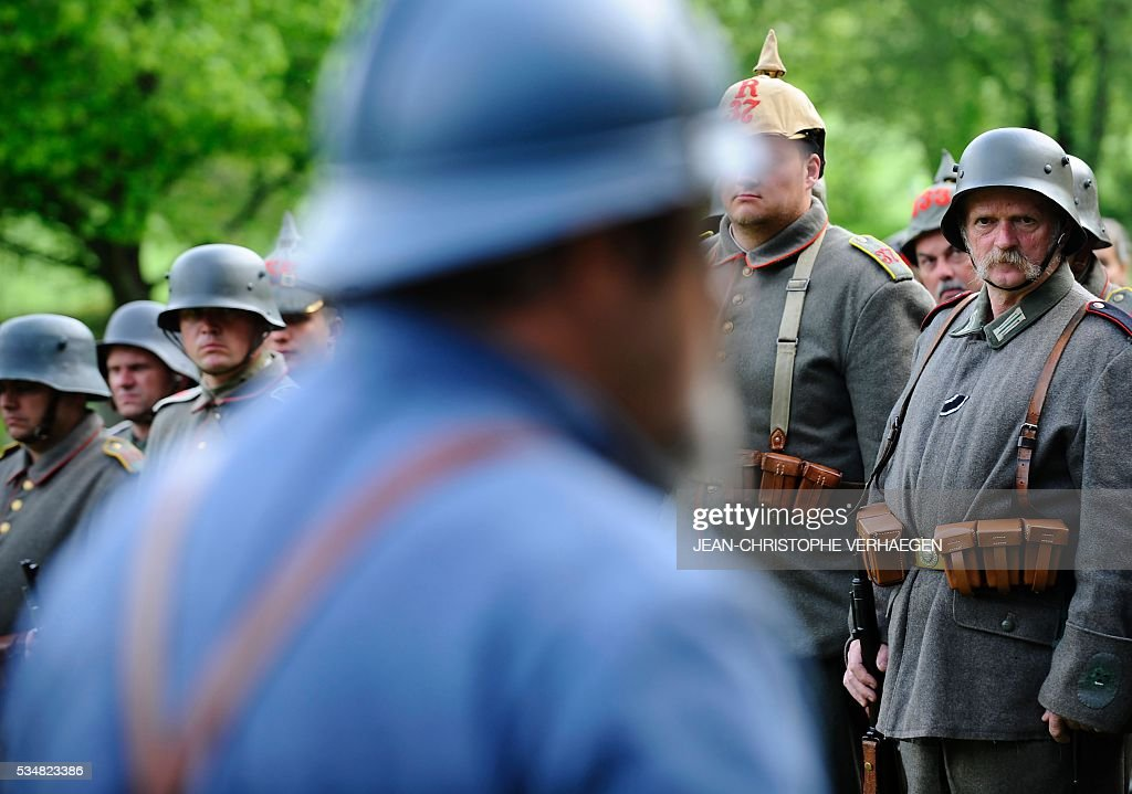 A reenactor dressed as a German soldier looks on during a ceremony at the German WWI cemetery of Troyon, eastern France, on May 28, 2016, as part of the 100-year commemoration of WWI's Battle of Verdun. VERHAEGEN
