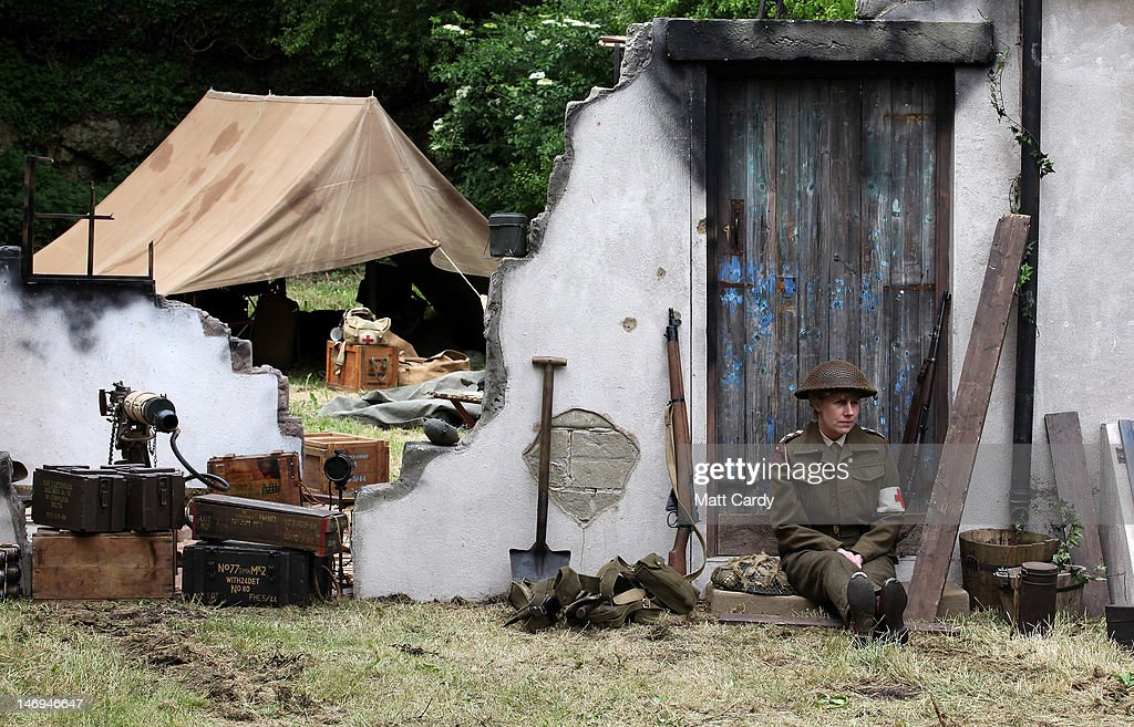 A re-enactor dressed as a Second World War British soldier sits in a ruined farm as part of the two-day Maiden Newton At War 1940s re-enactment weekend in Maiden Newton on June 23, 2012 near Dorchester, England. The quiet Dorset village of Newton Maiden was seen as a strategic hub during the Second World War and was heavily fortified against a threatened German invasion. It later saw hundreds of American servicemen quartered in the area before the D Day landings. To celebrate the village's wartime past, the biennial event, which started in 2008, has grown into one of the biggest re-enactments in the country and this year featured one of the largest convoys of Second World War vehicles seen in Dorset since D Day in 1944.