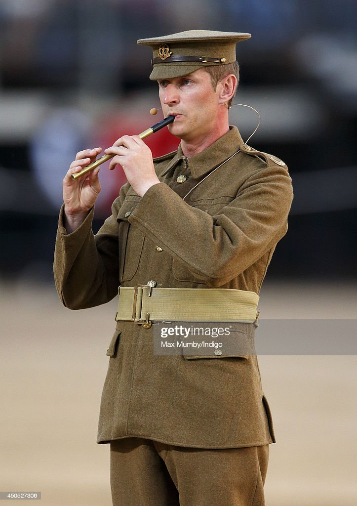 A WW1 re-enactor of The Great War Society performs in the Household Division's Beating Retreat, watched by Prince William, Duke of Cambridge on Horse Guards Parade on June 12, 2014 in London, England.