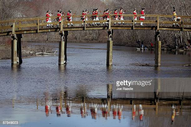 Reenactors dressed as British soldiers march on the North Bridge over the Concord River after battling the minutemen April 17 2006 in Concord...