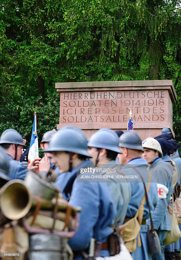 Reenactors dressed as French and German soldiers gather at the German WWI cemetery of Troyon, eastern France, on May 28, 2016, as part of the 100-year commemoration of WWI's Battle of Verdun. VERHAEGEN