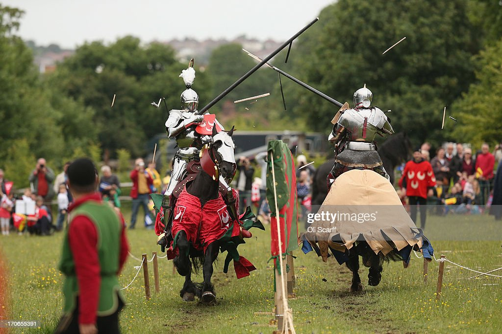 Re-enactors dressed as knights stage a medieval jousting competition at Eltham Palace on June 16, 2013 in Eltham, England. The 'Grand Medieval Joust' event at Eltham Palace, an English Heritage property which was the childhood home of King Henry VIII, aims to give a great insight into life at the palace during the medieval period.