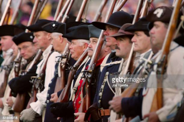 Reenactors dressed as the Lexington militia members wait in formation to fight the British soldiers during the Battle of Lexington April 17 2006 in...