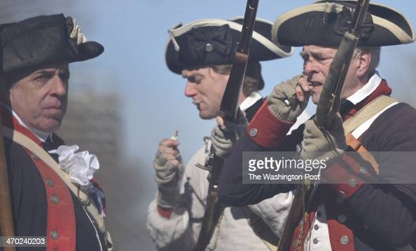 Reenactors dressed as the Virginia First Regiment participate in The Annual George Washington Birthday Parade in Alexandria Virginia on February 17...