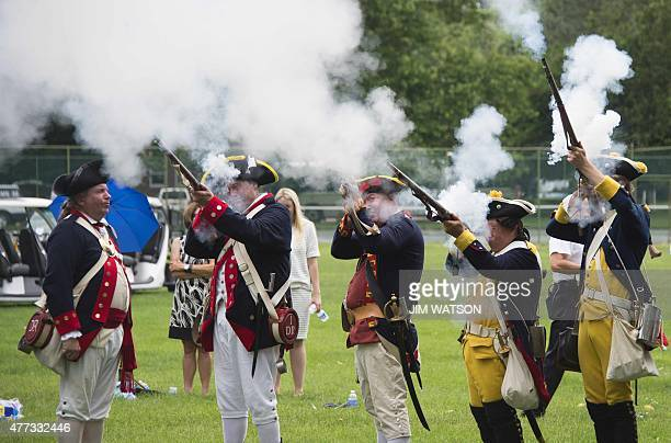 Reenactors fire muskets near the Sons of the American Revolution's French Monument on the campus of St John's College in Annapolis Maryland June 16...