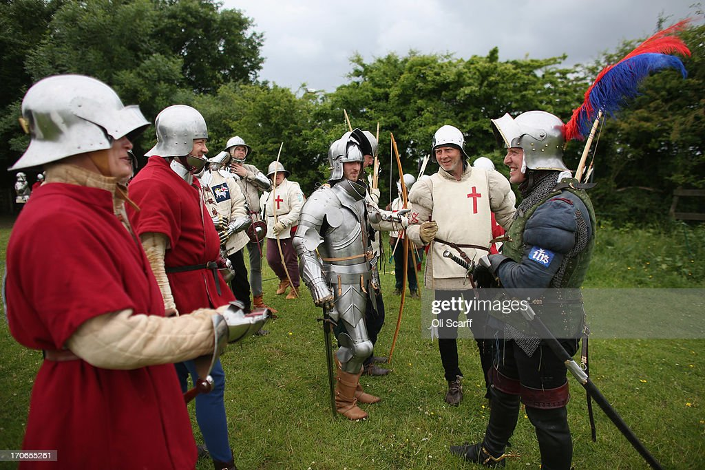 Re-enactors in period costume prepare to stage a medieval battle at Eltham Palace on June 16, 2013 in Eltham, England. The 'Grand Medieval Joust' event at Eltham Palace, an English Heritage property which was the childhood home of King Henry VIII, aims to give a great insight into life at the palace during the medieval period.