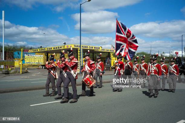 Reenactors parade past the Tarik hand Car Wash during the Manchester St George's Day parade on April 23 2017 in Manchester England Various parades...