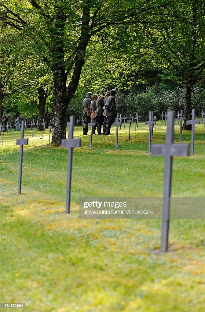 A reenactors pays his respects at the German WWI cemetery of Troyon, eastern France, on May 28, 2016, as part of the 100-year commemoration of WWI's Battle of Verdun. VERHAEGEN