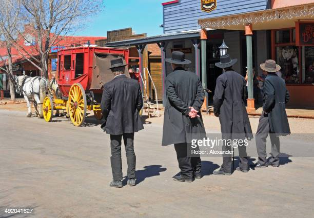 Reenactors portraying Wyatt Earp his brothers Morgan and Virgil Earp and Doc Holliday prepare for a gunfight in historic Tombstone Arizona The town...