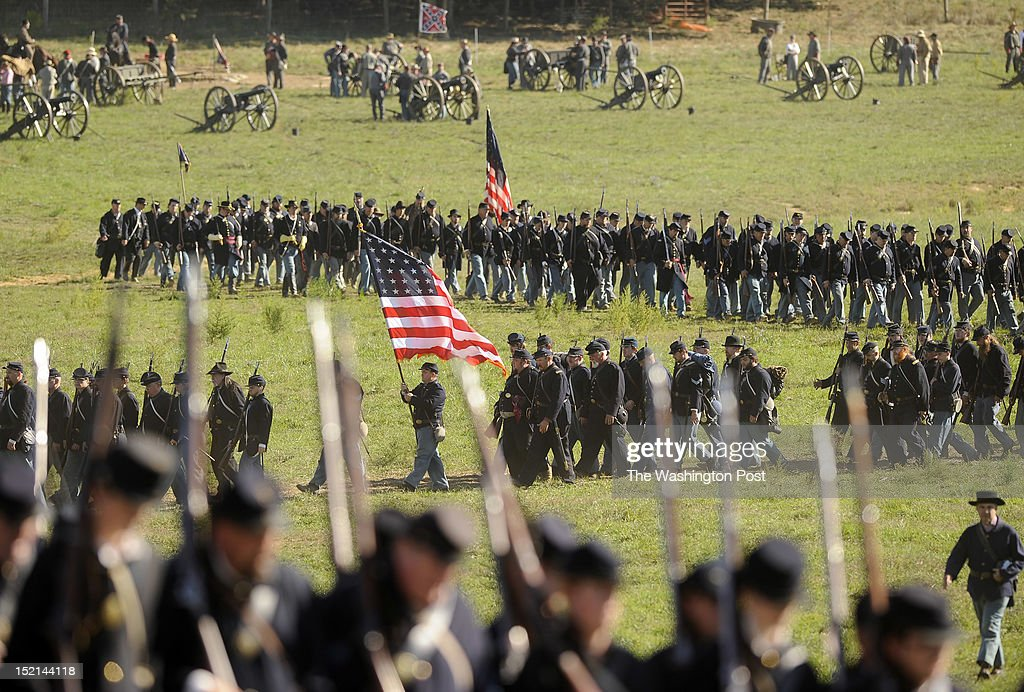 Reenactors take part in a recreation entitled 'Dunker Church' as people gather to mark the 150th anniversary of the Battle of Antietam on Saturday...