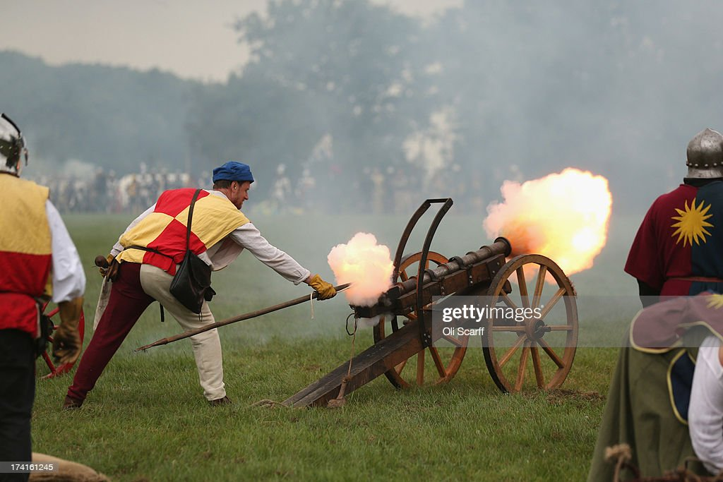 Re-enactors take part in the 'Battle of Tewkesbury' at the 'History Live!' event at Kelmarsh Hall in Northamptonshire on July 21, 2013 in Kelmarsh, England. The English Heritage event 'History Live!' brings together over 2000 re-enactors to animate 2000 years of English history. The re-enactment highlights include: the Battle of Hastings, Wars of the Roses, Roman soldiers and the D-Day landings.