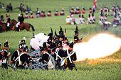 Reenactors take part in the first part of a reenactement of the Battle of Waterloo 'The French Attack' during the celebrations of the 200th...
