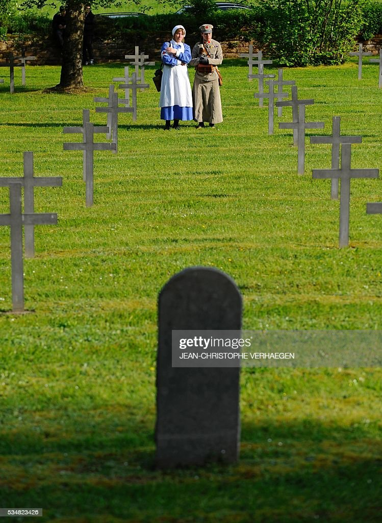 Reenactors walk through the German WWI cemetery of Troyon, eastern France, on May 28, 2016, during the 100-year commemoration of WWI's Battle of Verdun. VERHAEGEN