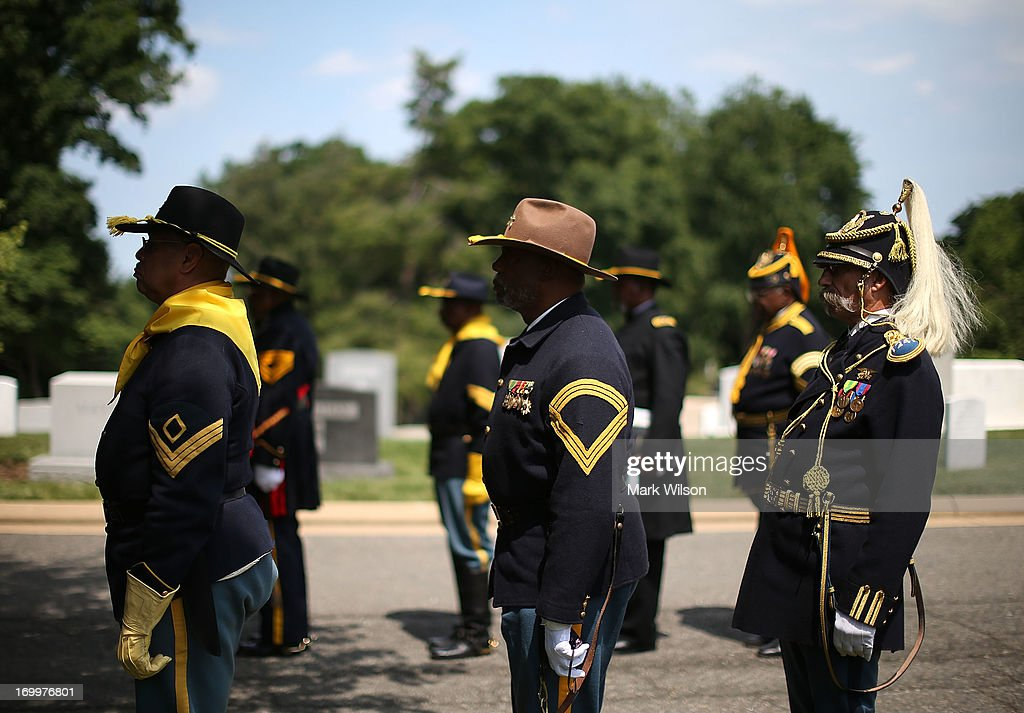 Reenactos dressed in period clothing attend a wreath laying ceremony at the gravesite of Buffalo Soldier Col. Charles Young, at Arlington Cemetery, June 5, 2013 in Arlington, Virginia. The event was hosted by the National Coalition of Black Veterans and the Omega Psi Phi Fraternity to celebrate the 90th anniversary of 'Buffalo Soldier' and military leader Col. Charles Young's internment in Arlington Cemetery.