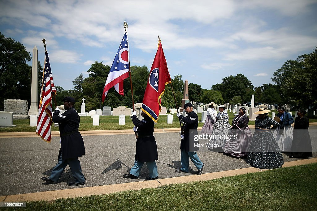 Reenactos dressed in period clothing attend an event at the gravesite of Buffalo Soldier Col. Charles Young, at Arlington Cemetery, June 5, 2013 in Arlington, Virginia. The event was hosted by the National Coalition of Black Veterans and the Omega Psi Phi Fraternity to celebrate the 90th anniversary of 'Buffalo Soldier' and military leader Col. Charles Young's internment in Arlington Cemetery.