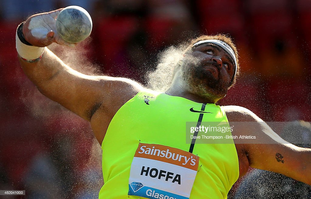 Reese Hoffa of the United States on his way to winning the men's shot put at Hampden Park on July 11, 2014 in Glasgow, Scotland.
