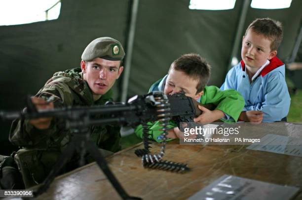 Reese Thompson aged 4 from Rathmolyon County Meath with his brother Jordan aged 6 are shown a general purpose machine gun by Cpl Daithi Mac Eamoinn...