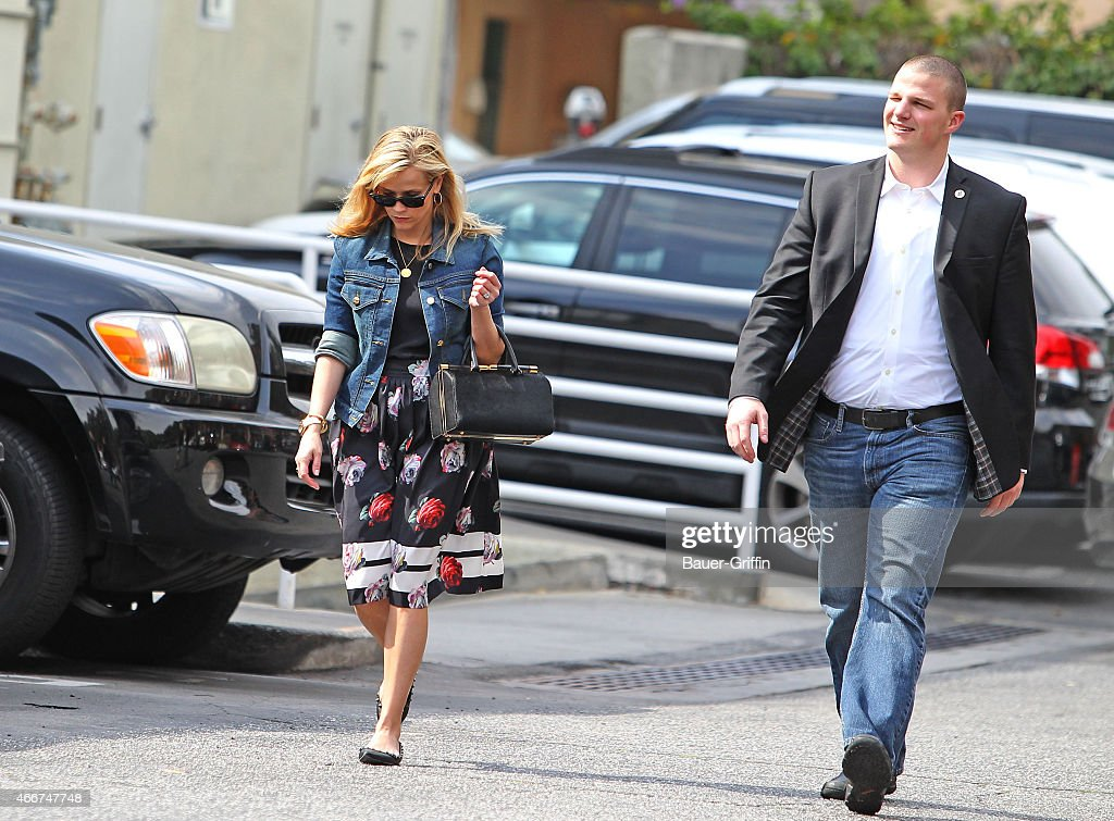 Reese Witherspoon and her bodyguard are seen on March 18 2015 in Los Angeles California