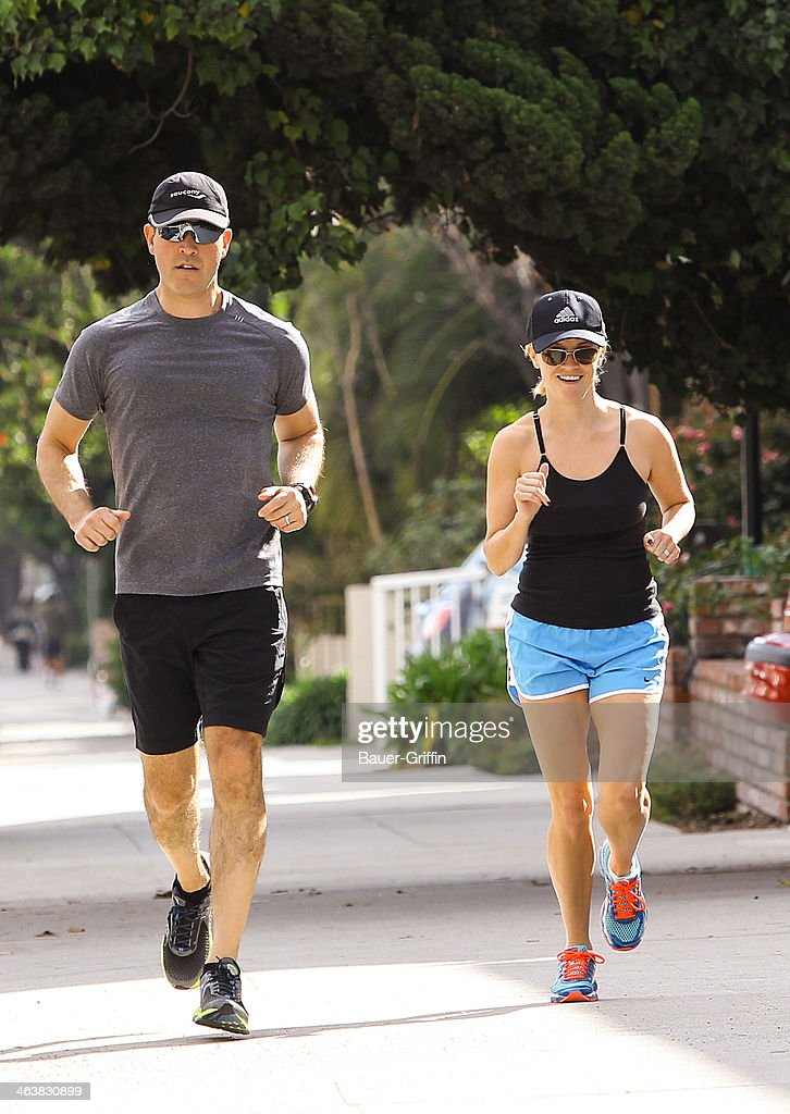 Reese Witherspoon and her husband Jim Toth are seen as they go for a jog on January 19 2014 in Los Angeles California