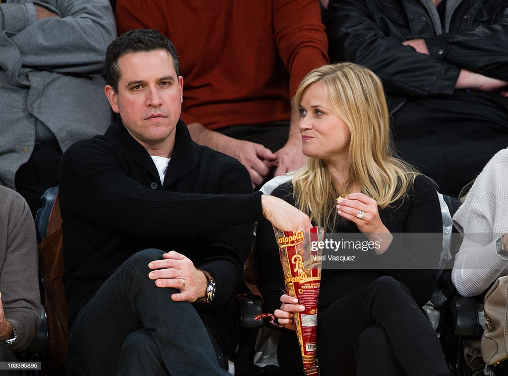 <a gi-track='captionPersonalityLinkClicked' href=/galleries/search?phrase=Reese+Witherspoon&family=editorial&specificpeople=201577 ng-click='$event.stopPropagation()'>Reese Witherspoon</a> (R) and her husband <a gi-track='captionPersonalityLinkClicked' href=/galleries/search?phrase=Jim+Toth&family=editorial&specificpeople=4543295 ng-click='$event.stopPropagation()'>Jim Toth</a> attend a basketball game between the Toronto Raptors and Los Angeles Lakers at Staples Center on March 8, 2013 in Los Angeles, California.