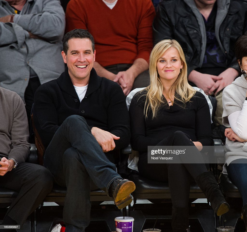 Reese Witherspoon and her husband Jim Toth attend a basketball game between the Toronto Raptors and Los Angeles Lakers at Staples Center on March 8...