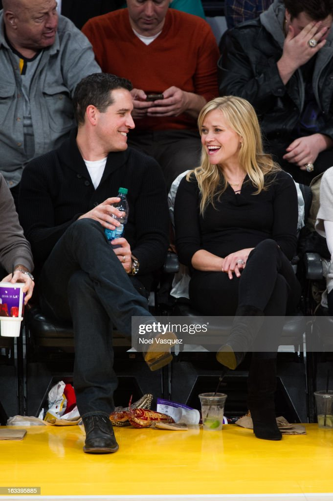 Reese Witherspoon and her husband Jim Toth attends a basketball game between the Toronto Raptors and Los Angeles Lakers at Staples Center on March 8...