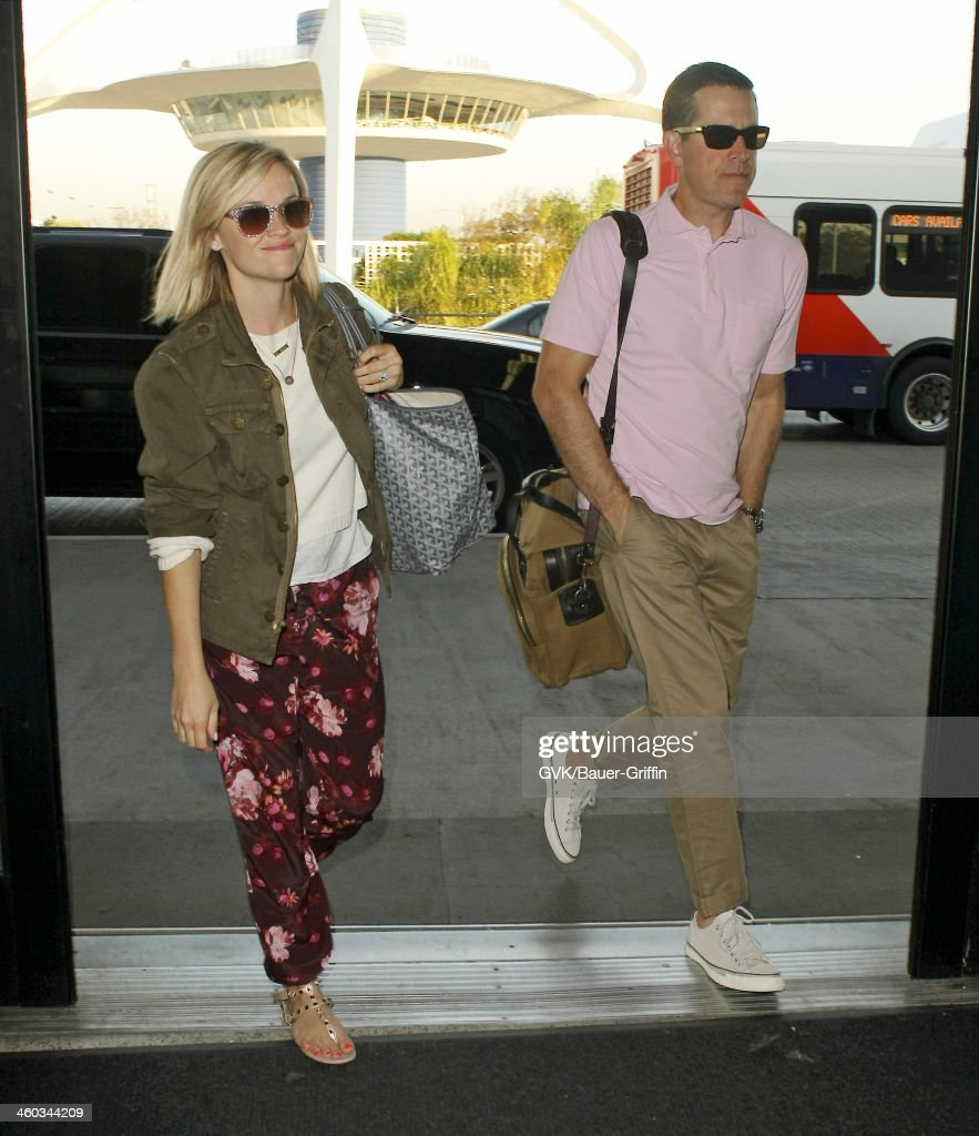 Reese Witherspoon and Jim Toth are seen arriving at LAX airport on January 03 2014 in Los Angeles California