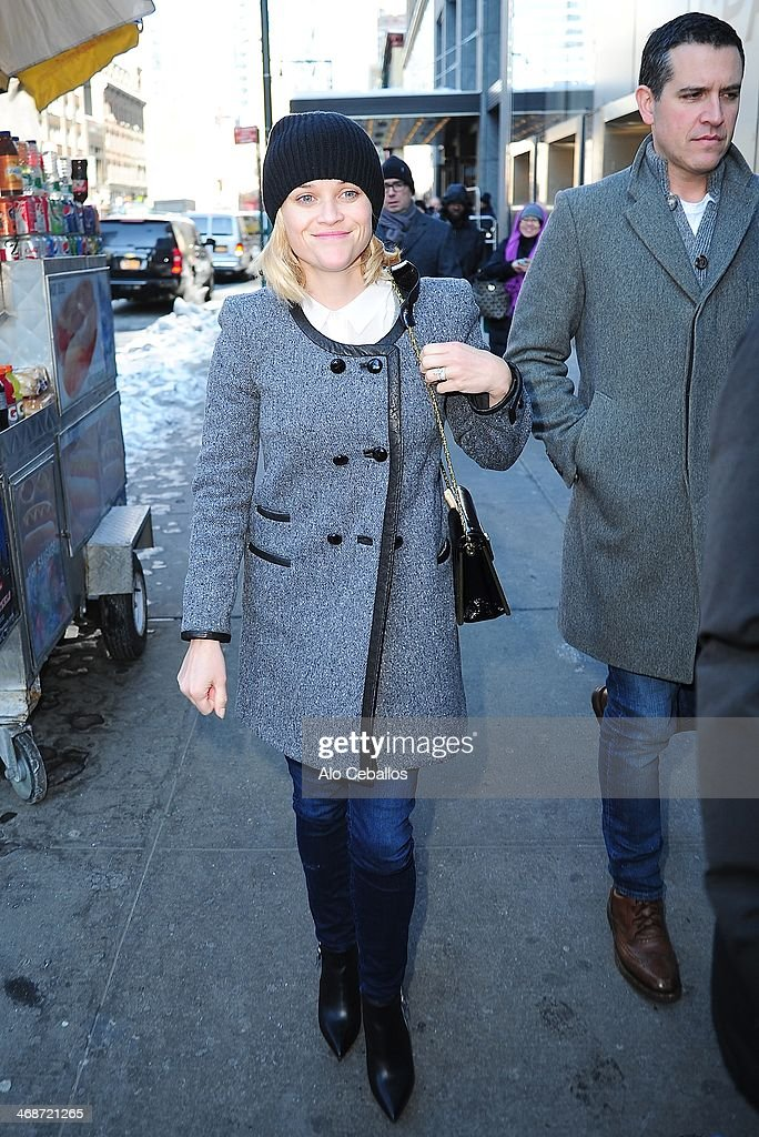 Reese Witherspoon and Jim Toth are seen in Times Square on February 11 2014 in New York City