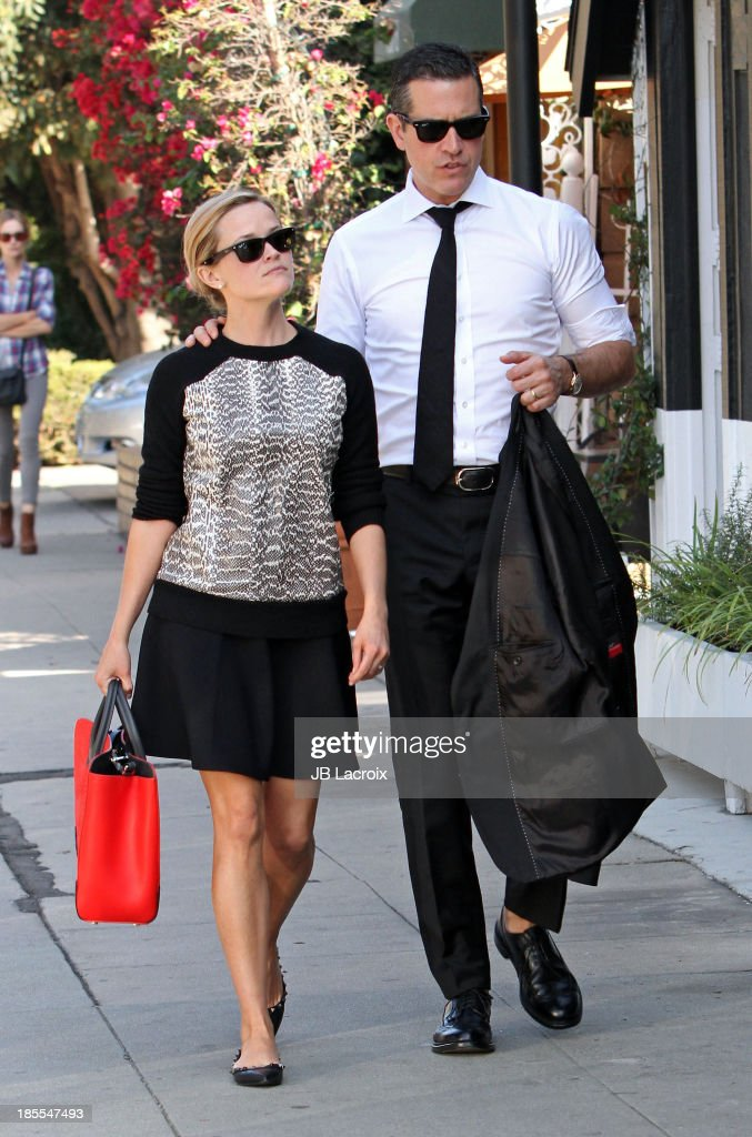 <a gi-track='captionPersonalityLinkClicked' href=/galleries/search?phrase=Reese+Witherspoon&family=editorial&specificpeople=201577 ng-click='$event.stopPropagation()'>Reese Witherspoon</a> and <a gi-track='captionPersonalityLinkClicked' href=/galleries/search?phrase=Jim+Toth&family=editorial&specificpeople=4543295 ng-click='$event.stopPropagation()'>Jim Toth</a> are seen on October 21, 2013 in Los Angeles, California.