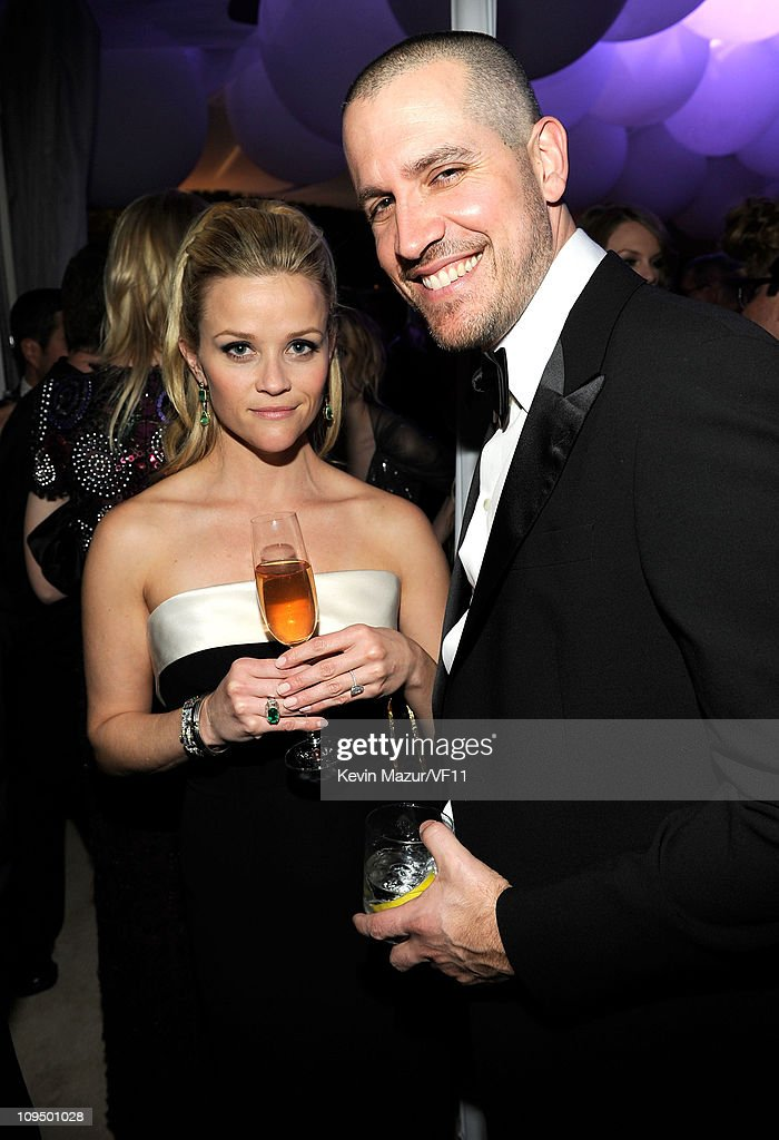 Reese Witherspoon and Jim Toth attend the 2011 Vanity Fair Oscar Party Hosted by Graydon Carter at the Sunset Tower Hotel on February 27 2011 in West...