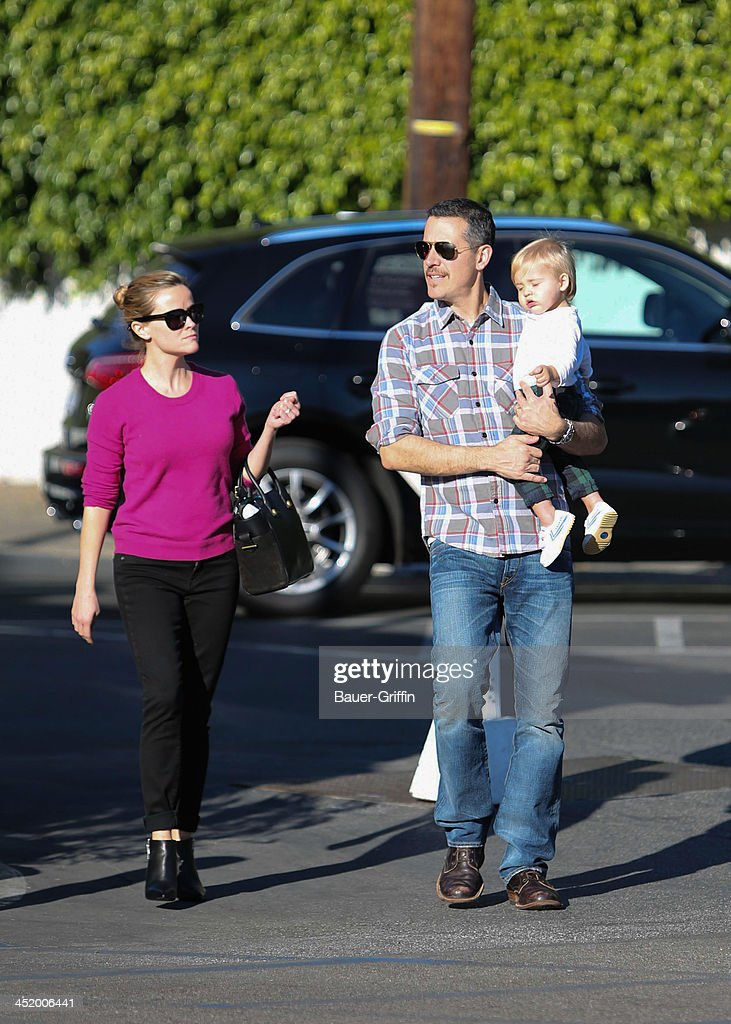 Reese Witherspoon and Jim Toth with son Tennessee are seen on November 25 2013 in Los Angeles California