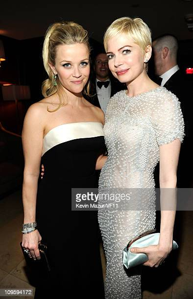 Reese Witherspoon and Michelle Williams attend the 2011 Vanity Fair Oscar Party Hosted by Graydon Carter at the Sunset Tower Hotel on February 27...