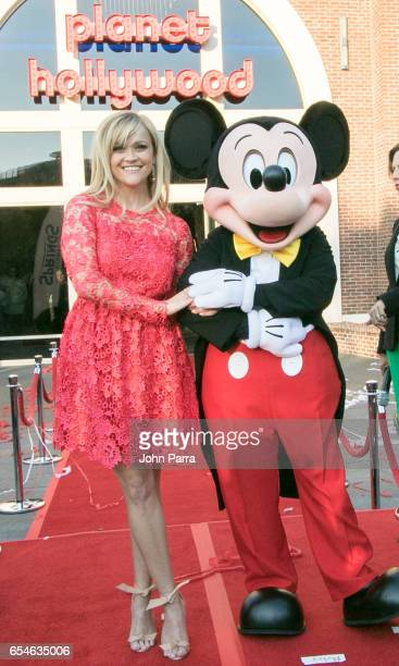Reese Witherspoon and Mickey Mouse Officially Open Planet Hollywood Disney Springs on March 17 2017 in Orlando Florida