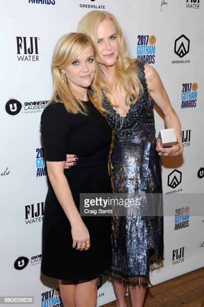 Reese Witherspoon and Nicole Kidman pose with her award at The 2017 IFP Gotham Independent Film Awards cosponsored by Landmark Vineyards at Cipriani...