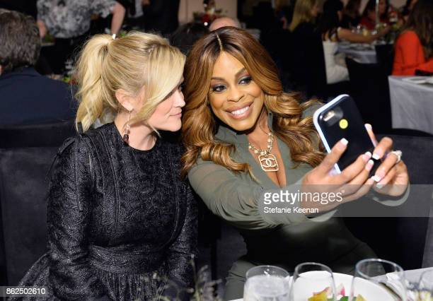 Reese Witherspoon and Niecy Nash attend ELLE's 24th Annual Women in Hollywood Celebration presented by L'Oreal Paris Real Is Rare Real Is A Diamond...