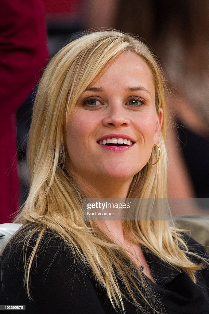 Reese Witherspoon attends a basketball game between the Toronto Raptors and Los Angeles Lakers at Staples Center on March 8, 2013 in Los Angeles, California.