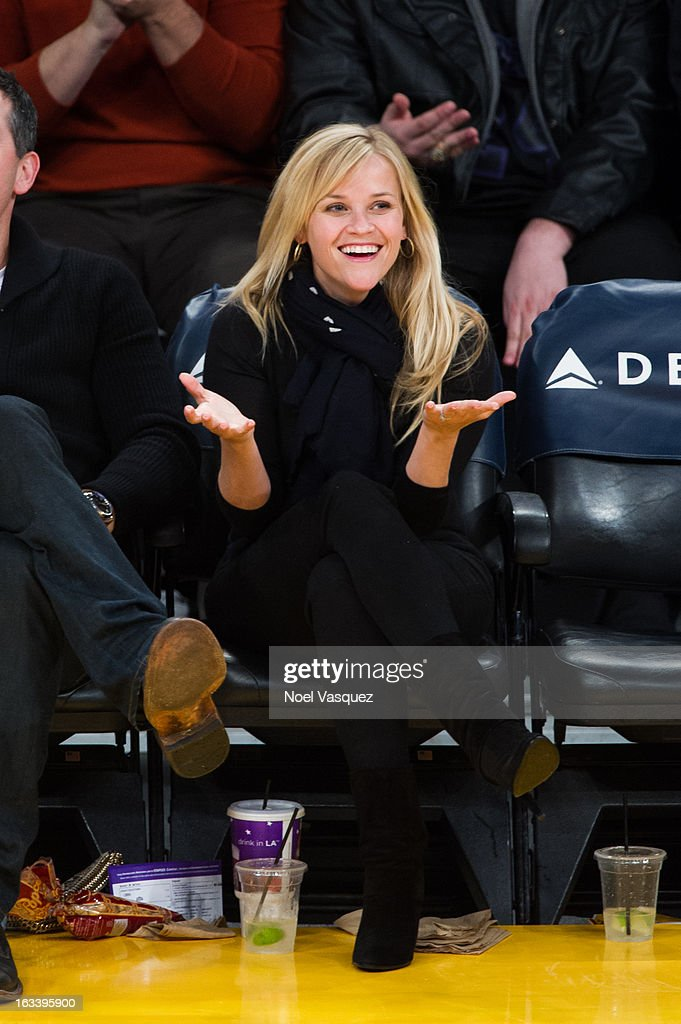 <a gi-track='captionPersonalityLinkClicked' href=/galleries/search?phrase=Reese+Witherspoon&family=editorial&specificpeople=201577 ng-click='$event.stopPropagation()'>Reese Witherspoon</a> attends a basketball game between the Toronto Raptors and Los Angeles Lakers at Staples Center on March 8, 2013 in Los Angeles, California.