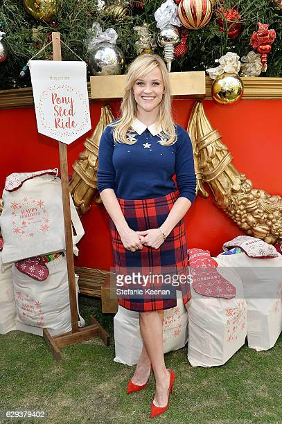 Reese Witherspoon attends Tiny Prints Presents The Baby2Baby Snow Day at The Grove on December 12 2016 in Los Angeles California