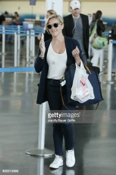 Reese Witherspoon is seen at JFK on August 18 2017 in New York City