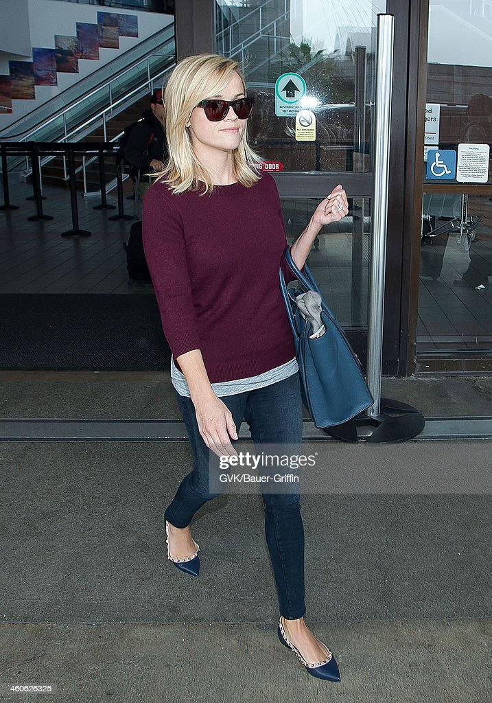 Reese Witherspoon is seen at Los Angeles International Airport on September 09 2013 in Los Angeles California