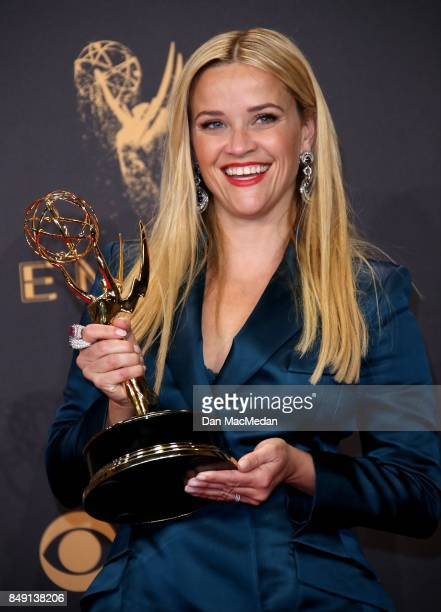 Reese Witherspoon poses in the press room with her Emmy award for Outstanding Limited Series for 'Big Little Lies' at the 69th Annual Primetime Emmy...