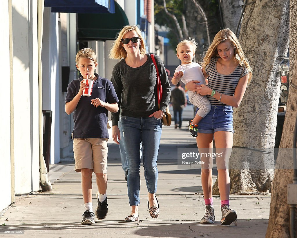 Reese Witherspoon with her children, Deacon Phillippe, Ava Phillippe and Tennessee Toth are seen on December 20, 2013 in Los Angeles, California.