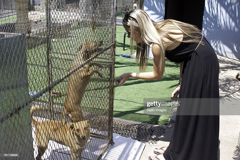 Reeva Steenkamp visits the Kitty and Puppy Haven on January 25, 2013 in Johannesburg, South Africa.