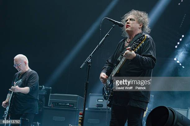 Reeves Gabrels and Robert Smith from The Cure perform at AccorHotels Arena on November 15 2016 in Paris France