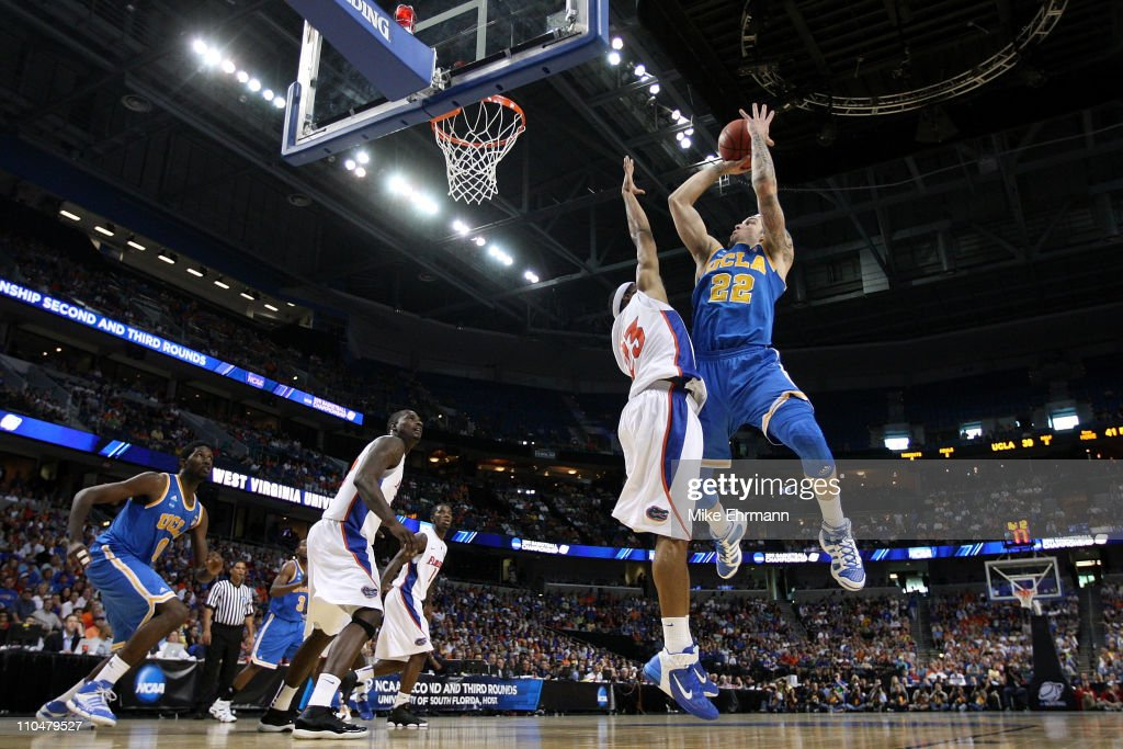 Reeves Nelson of the UCLA Bruins drives for a shot attempt against Alex Tyus of the Florida Gators during the third round of the 2011 NCAA men's...