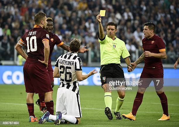 Refere Gianluca Rocchi gives a yellow card to Juventus' defender from Switzerland Stephan Lichtsteiner during the Italian Serie A football match...