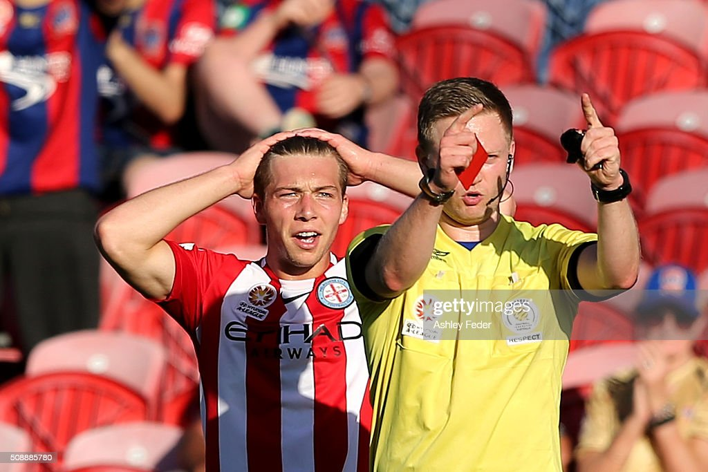 Referee Adam Fielding issues a red card to Jacob Melling of Melbourne City during the round 18 A-League match between the Newcastle Jets and Melbourne City FC at Hunter Stadium on February 7, 2016 in Newcastle, Australia.
