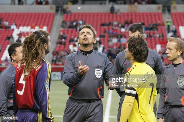 Referee Alex Prus tosses the coin with Kyle Beckerman of Real Salt Lake and Guillermo Barros Schelotto Columbus Crew prior to the game at Rio Tinto...